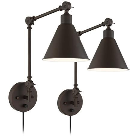 I used these to flank a window and they look so good.The price is amazing and they are a plug in wall sconce.  Wray Bronze Metal Swing Arm Wall Lamp Set of 2