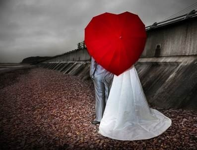Heart-shaped wedding umbrella - because you never know what the weather's going to do in the Ireland!