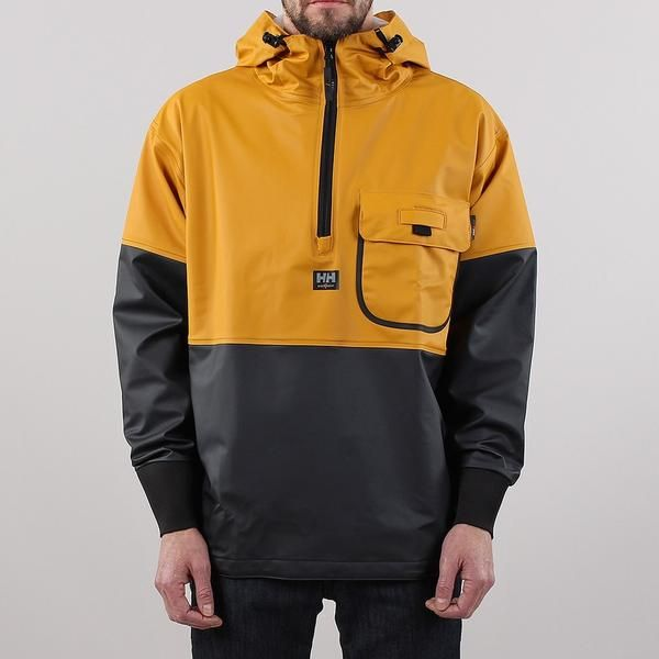 """TheHelly Hansen Roan Anorak in Ochre/Charcoal has a PU (Polyurethane) coating on 100% polyester making this jacket water and oil proof, lightweight and flexible. A click on loop at the chest holds an ID card holder along with a flap and press studded closure for the left chest pocket. A half zip gives an easy way to take on and off with ribbed cuffs and an adjustable drawstring hood and waistband to keep in the heat. Our model is 6ft tall with a 38"""" chest and wears a size Medium"""