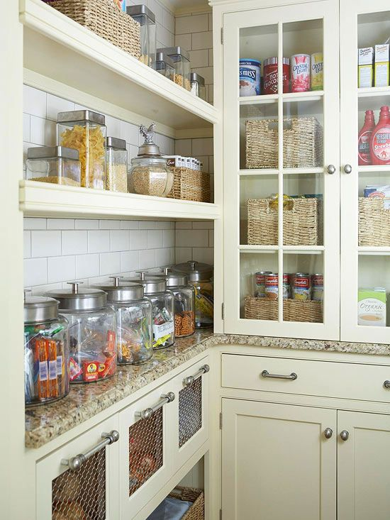 Get Organized with Kitchen Storage. I love how they used inexpensive glass jars, baskets and tins to store everyday food items.
