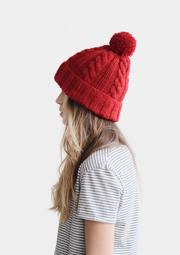 Handknitted unisex beanie hat with handmade pom pom.  **YARN:** Wool blend.  **COLORS:** Here shown in Bright Red. You can choose any of the colours shown in the samples. Please leave a note...