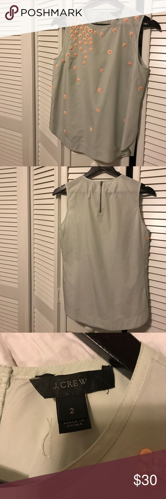 J. Crew. Great Condition. Silk Shell. J. Crew. Dry Cleaned. Sleeveless Silk mint green embellished with white seed pearls & peach sequins. Beautiful! Bronze Sipper in back. Semi-Fitted. Has a little Lycra for extra give. Can be worn with tailored skirt, pants, or casual with jeans & blazer. Dry Clean Only. J. Crew Tops Blouses