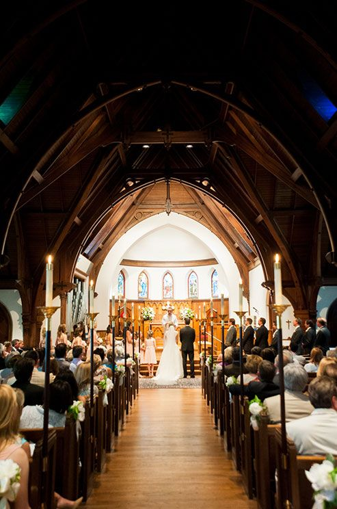 Guests look on as the bride and groom get ready to exchange their vows at the Trinity Cathedral in Maryland.