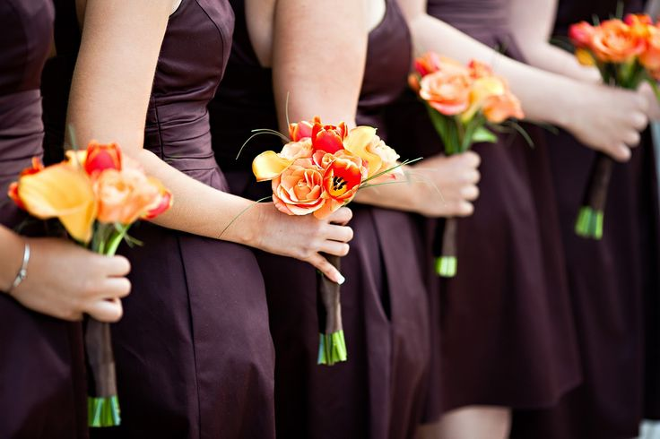 bridesmaids #bouquets for an #orange and chocolate #brown #wedding