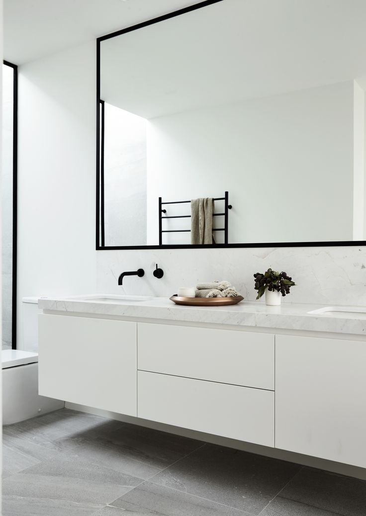 Our Lubelso Contemporary Facade Has Been Reinvented For New Concept Home In Brighton Sleek Black Framed MirrorWhite Vanity MirrorBlack Bathroom