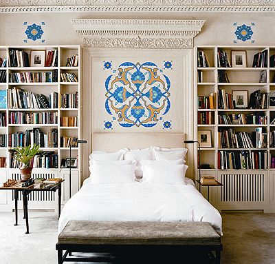 We love the design elements in this room, from the carvings over the bed to the pops of color via the wall paintings.