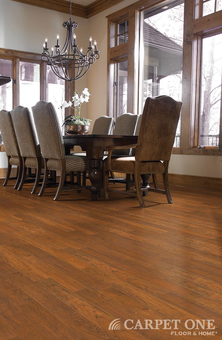 Laminate floors from Carpet One in a rustic dining room.