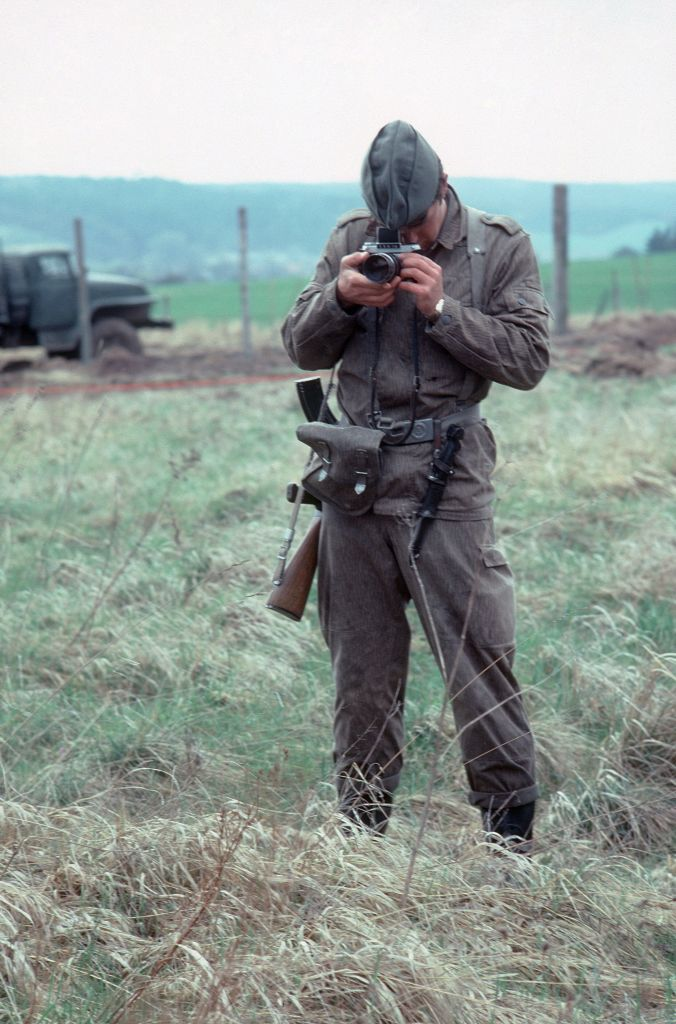 East german soldier taking pictures
