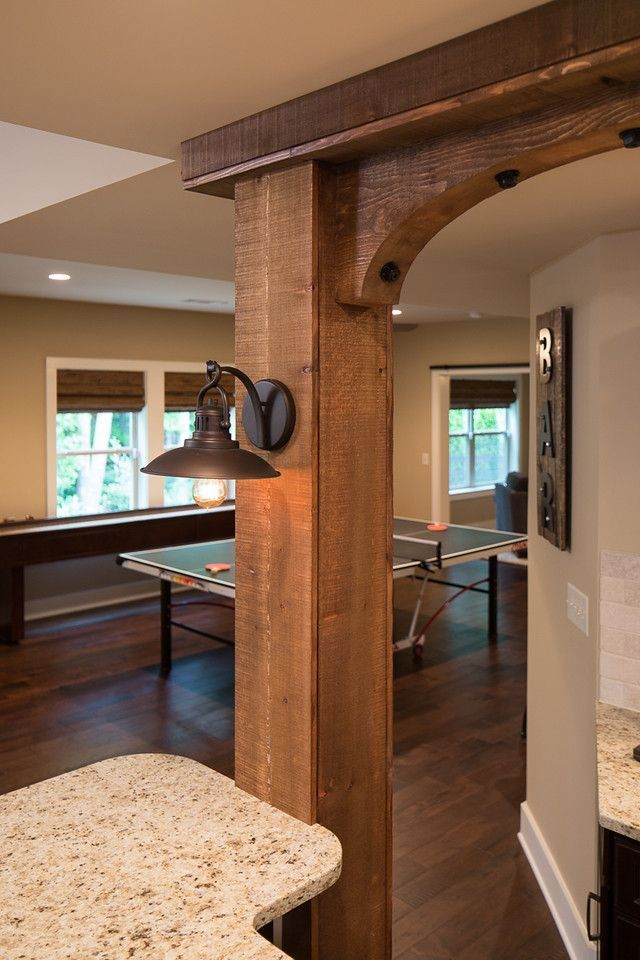 Close Up Of Cedar Beams Supporting The Wrap Around Bar With Granite And Industrial Sconces Kitchen Columns Beams Living Room Basement Remodel Diy