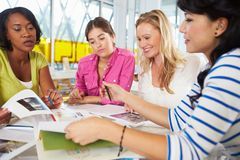 Group Of Women Meeting In Creative Office Stock Photos