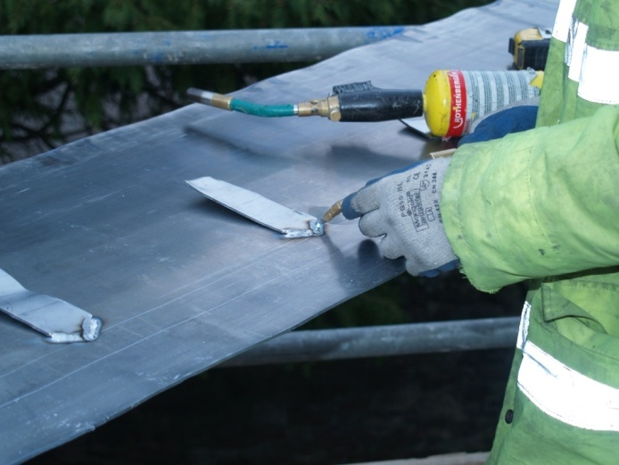 soldering in place tabs to take the sacrificial ribbon on the roof valley