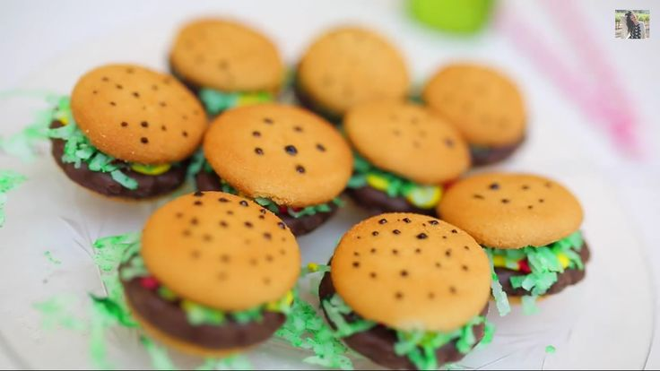 Cute hamburger treats! (Via Bethany Mota -YouTube) What you'll need: Vanilla Wafers (Grocery) Grasshopper Cookies or Thin Mint Girl Scout cookies ( Girl Scout/Grocery Store) Sweetened Coconut Shreds (Grocery) Food Coloring (you'll have it somewhere lol) Red, Yellow Icing. First Lay Two Vanilla Wafers Out. Next, take the cookie and put it in between the Wafers. Then put the coconut shreds into bowl and add a few drops of green food coloring. Finally put each icing on to resemble…