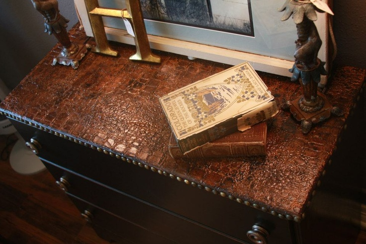 Wow!!! We refinished a small chest of drawers and used Wood Icing texture to create a faux crocodile top! It is bordered with vintage studs to give it a realistic leather look! One of our favorites!