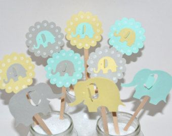 Navy & Blue Elephant Cupcake toppers. MORE ELEPHANTS HERE https://www.etsy.com/shop/sunshowerstuff?section_id=11320417&ref=shopsection_leftnav_5&ga_search_query=grey%2Belephants   This is for qty 12. You will receive 4 of each color. Navy blue, sky blue and white Elephant Cupcake Toppers. This is a great color combination. elephant ear sticks out a little. Cute!  These are very cute and are great for topping off that cupcake at that special Baby ...