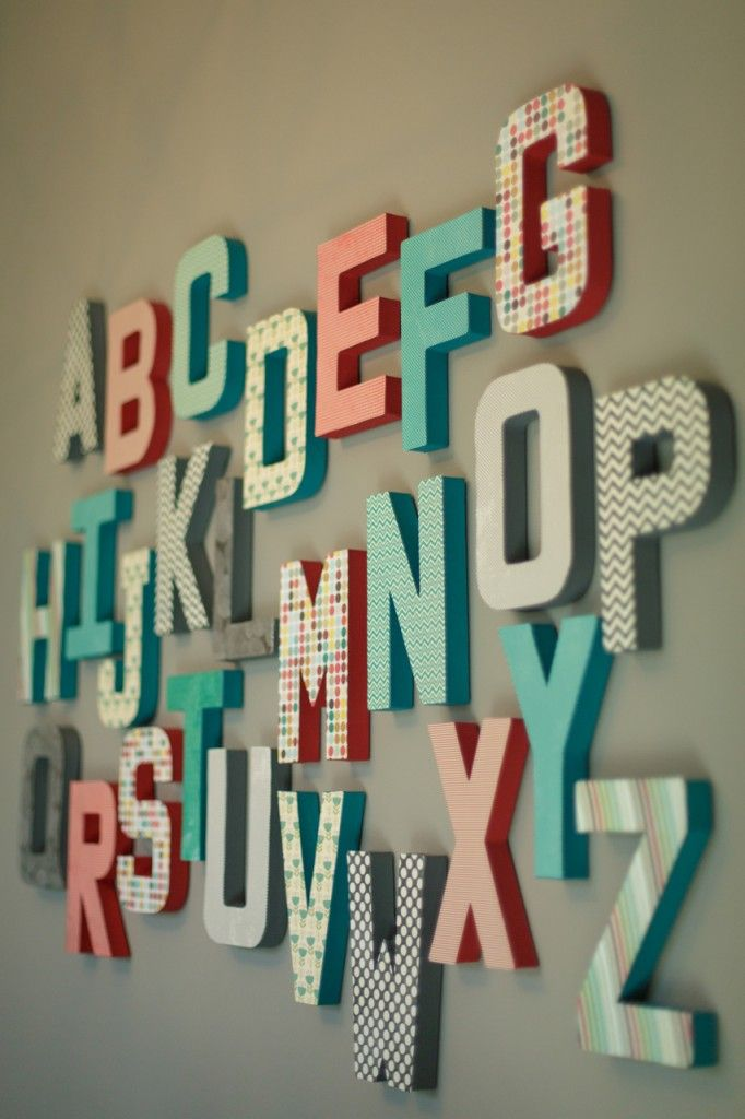 Alphabet wall in the #nursery - DIY'd with scrapbook paper