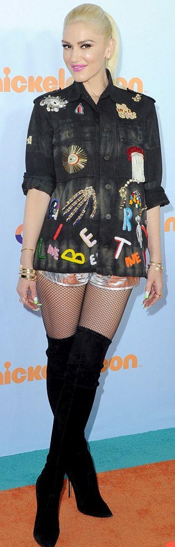 Who made  Gwen Stefani's shorts, black print jacket, and thigh high boots?