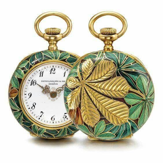 Pendant watch with chestnut leaf decoration, Patek Philippe, c1896, 1898. Gold, cloisonné enamel.