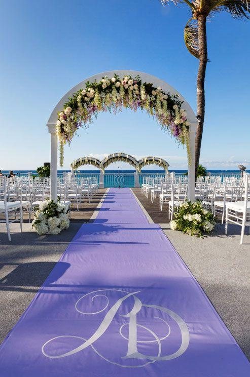 The lavender aisle runner features the couple's monogram in crisp white.