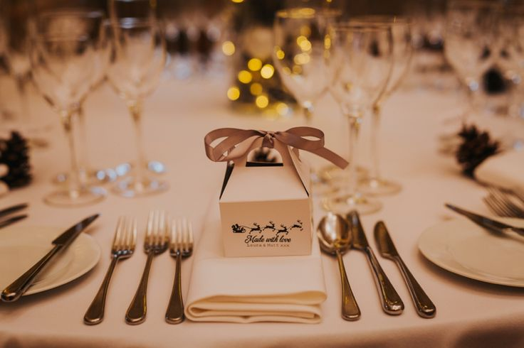 Beautifully packaged wedding favours with Father Christmas and his reindeer. Photo by Benjamin Stuart Photography #weddingphotography #weddingfavour #christmaswedding #weddingbreakfast #receptiondecor