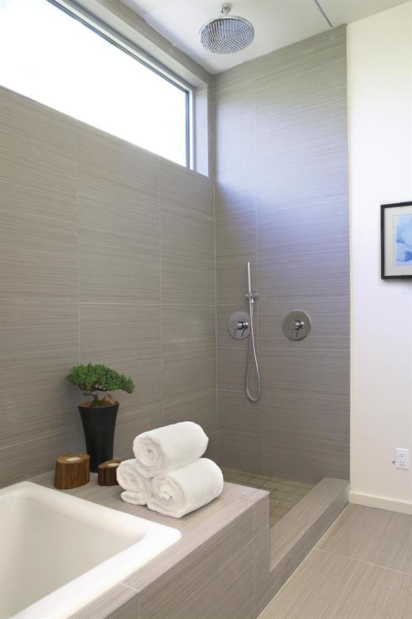 This bathroom has a recessed shower curtain track / Sometimes you don't need to invest in glass shower doors