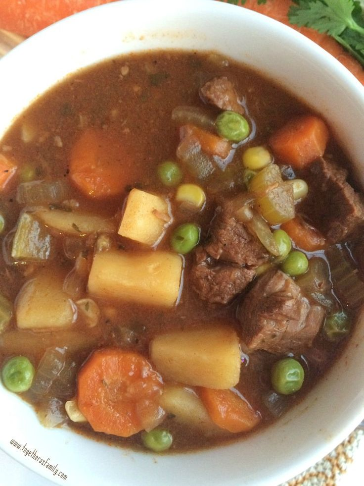 """Ultra tender beef, vegetables, and potatoes cooked all day in a flavorful tomato beef broth! This slow cooker beef stew is the ultimate comfort food and it will warm you right up. For the month of January I am going to try to not post lots of sugar & sweet recipes. I say """"try"""" because …"""