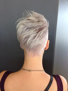 Asymmetrical Hair Cut. Don't know how I would feel about all the hair in the back, but it would cover up my cowlicks.
