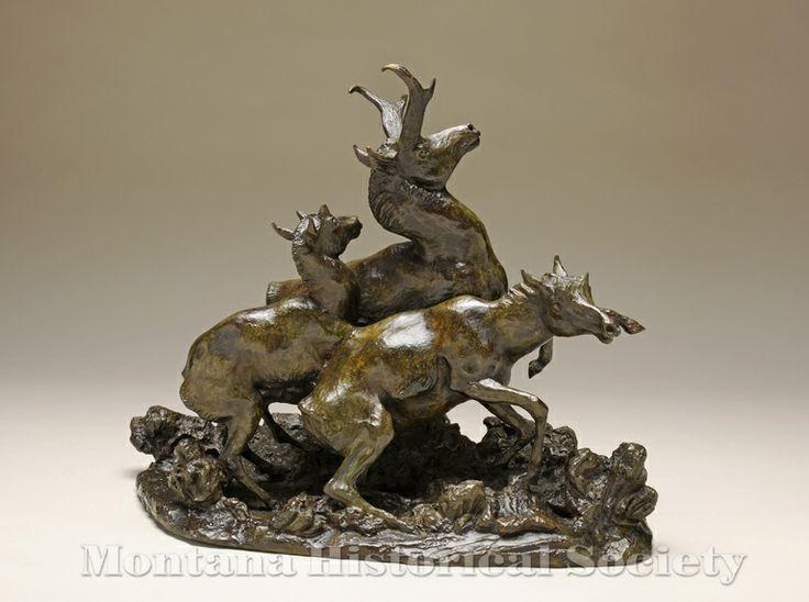 2000.15.82, Pronghorns in Action (back), Bob Scriver, Bronze, 1955