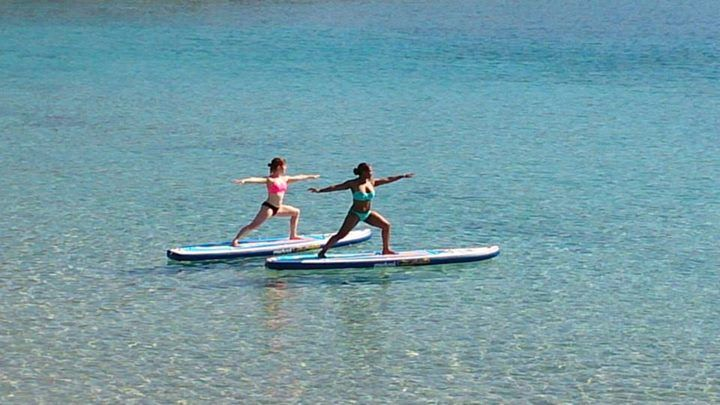 Early morning SUP Yoga class with Nefeli Stamouli at Loutraki beach, Chania Crete on our Mistral boards.  http://paddleboardyoga.net/