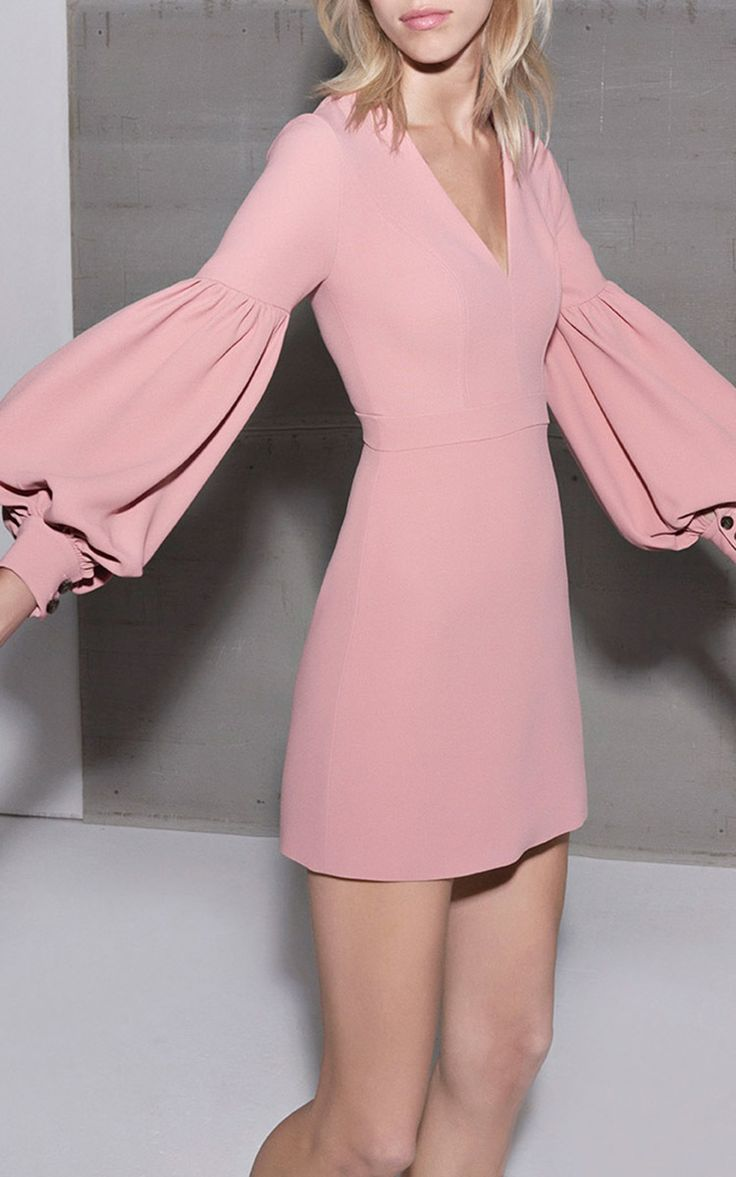 This Ellena dress features a deep v-neck with gathered blouson sleeves and an a-line silhouette with a mini length hem. Cuffed balloon sleeves. Duel button fastenings at cuffs. Concealed back zip. Composition: 50% viscose, 50% acetate. Color: ash pink. 100% polyester lining (Alexis)