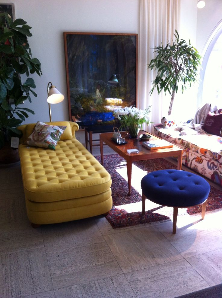 Not all Scandinavian homes are just white, Svenskt Tenn's furnitures add color to the interior.