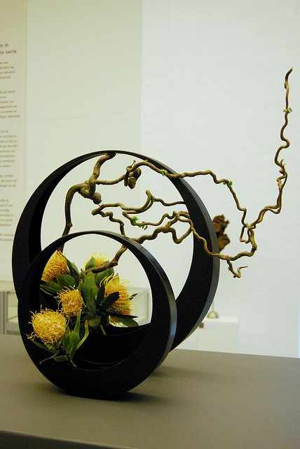 Ikebana at Yoshitoshi expo by Otomodachi, via Flickr