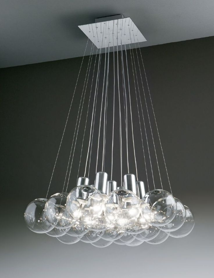 Hanging lamp with crystal blown spheres, stainless steel plate to the ceiling and bulb socket covers in chromium plated aluminium. design by Marco Agnoli for SP LIGHT and DESIGN