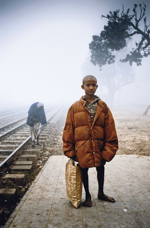 Arif �Tokai� (Arif �The Collector�) 2009 by Amy Helene Johansson (From The Series Winter At Tongi Railway Station, Bangladesh January 2009)