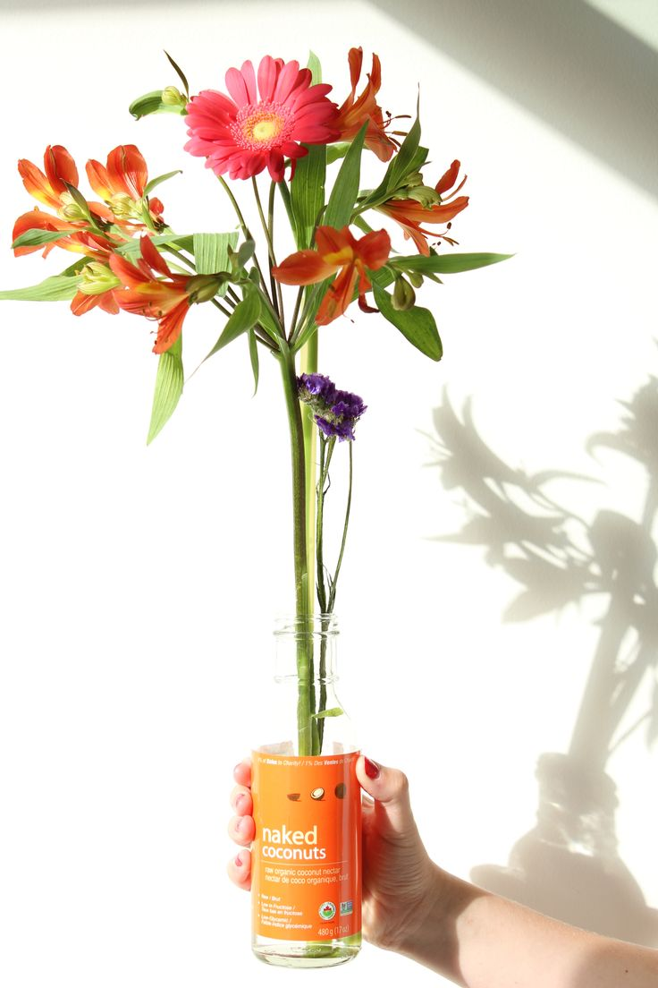 The best way to recycle our glass bottles is to turn them into vases! Our Coconut Nectar bottle is a beautiful orange - but what's inside is pure heaven. #CoconutNectar #Flowers #Recycle #Reuse #Coconut #Sun #Summer