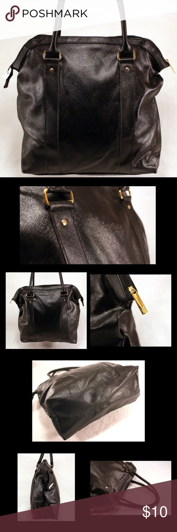 """ESTEE LAUDER Black Saffiano Style Bag ESTEE LAUDER Black Saffiano Style Bag with Gold Tone Hardware and Zipper Pull.  Manmade materials.  15.75x13.5x5.5"""" with 6"""" strap drop.  Minimal wear consistent with prior usage.  Nice looking bag! Estimated Value $35. Estee Lauder Bags"""