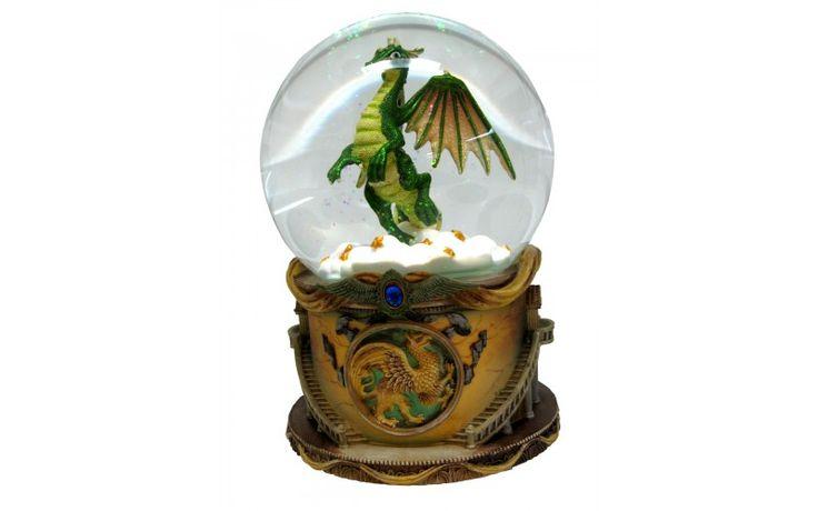 Dimension: 120 mm. Fonction: musique, rotation et brillants. Mélodie: Sonate à la lune. Base en résine, globe de verre.