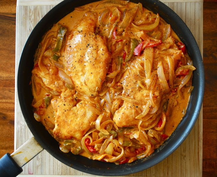 Hungarian Chicken Paprikash: Chicken paprikash with chicken pieces, browned in butter, cooked with onions and paprika, then served with a little sour cream mixed in.  For Recipe Details:http://www.shopcookserve.com/recipe/2223/Hungarian-Chicken-Paprikash