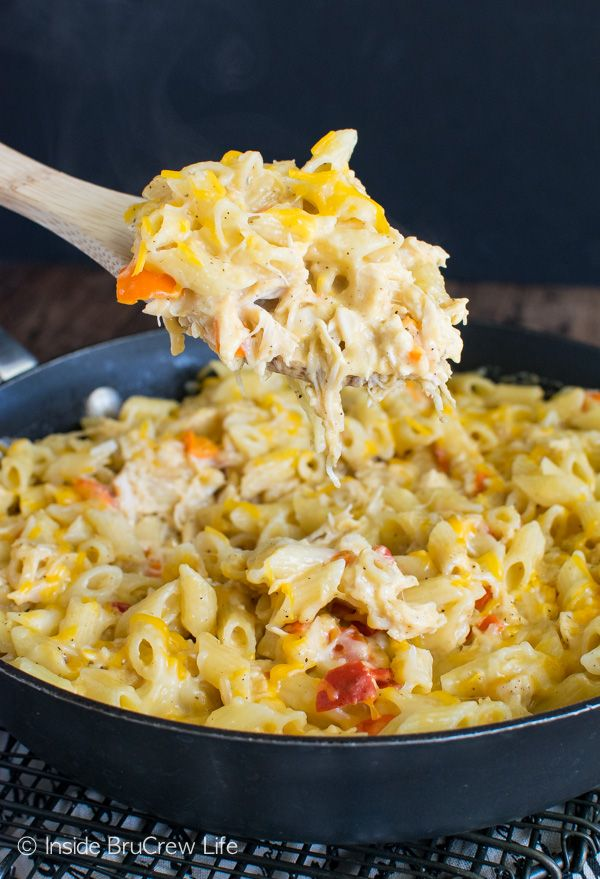 This Cheesy Chicken Pasta can be on the table in under 30 minutes. Pasta, chicken, & gooey cheese always gets smiles from everyone.