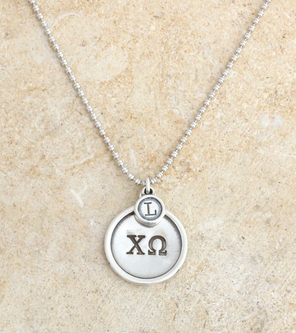 The Chi Omega greek letters have never looked so great!   The letters are stamped on a cirlce charm and an initial charm is added to make a personalized piece for any Chi O.  Give the gift which will symbolize a lifetime of sisterhood ~ or better yet, order one for yourself!