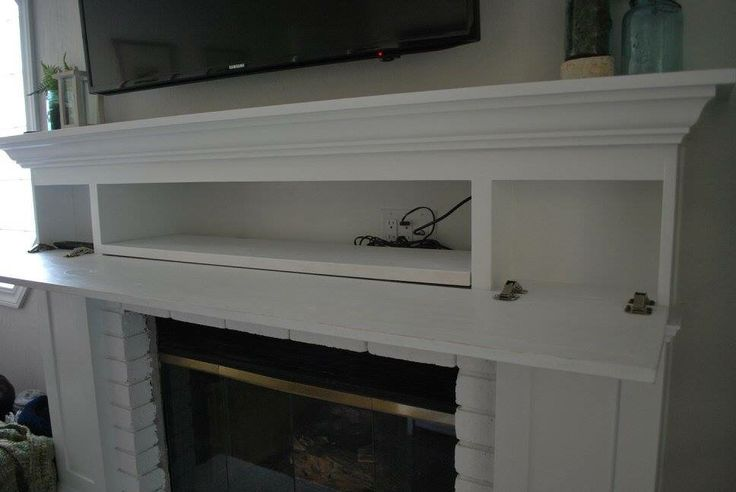 Hidden components in the fireplace mantle | Inredning