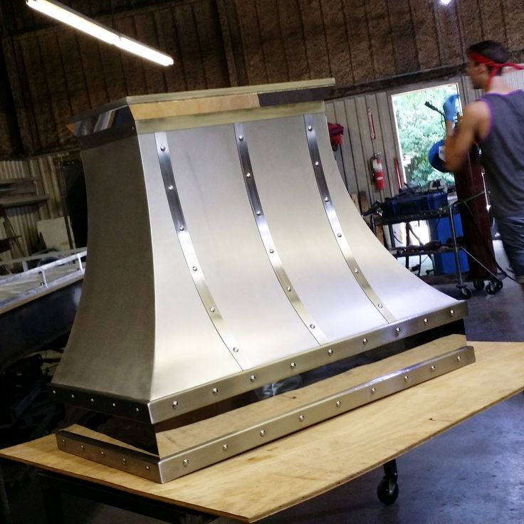 """Stainless steel range hood. Polished/Mirrored stainless steel accents. 48"""" wide with blower"""