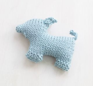 Knitted flat and seamed together, you can make this animal friend and create a cuddly toy zoo for the playful child in your life. (Lion Brand Yarn)