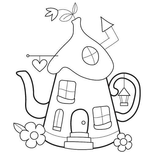 théière en forme de maison pixie