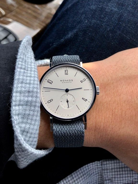 https://www.reddit.com/r/Watches/comments/8axtp9/nomos_tangente_my_first_mechanical_watch/