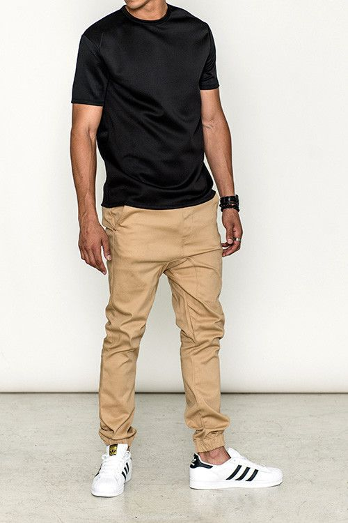- Denim and twill blend jogger in khaki - Stretch waist - Multiple pocket construction - Ribbed cuffs for a snug fit - Regular fit around waist - Regular fit through legs