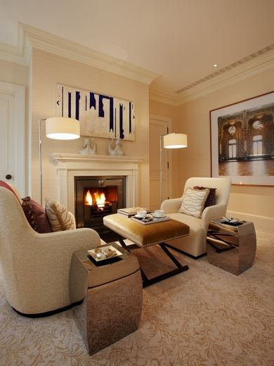 The Master Bedroom Suite seating area with a working gas marble fireplace.