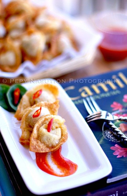 Fried Wonton (Pangsit Goreng).  A Chinese-Indonesian popular snack. An Indonesian taken of fried wonton by dipping it into chili sauce