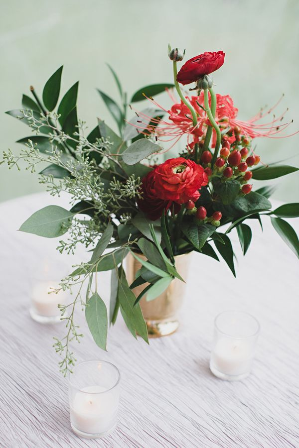 ranunculus and berry centerpiece, photo by Jon Schaaf Photography http://ruffledblog.com/intimate-charlottesville-wedding #weddingideas #centerpieces