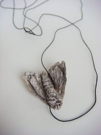 Mielle Harvey - Moth with Holes(back): 2009, 1in, lost wax cast sterling silver, silk cord
