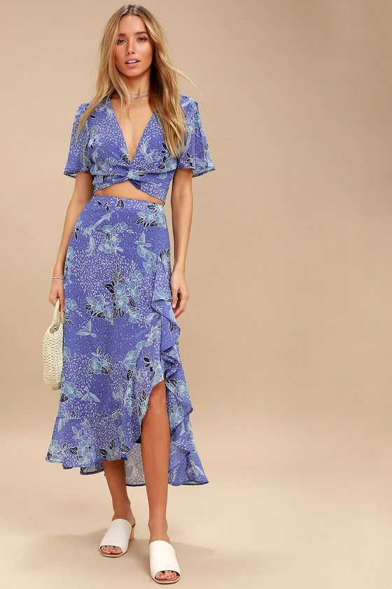 Lulus Exclusive! Breathtaking vacation destinations deserve a tropical piece like the Views Periwinkle Blue Floral Print Two-Piece Maxi Dress! Soft and breezy woven poly creates a fluttering short sleeve crop top with a tie-front, and a whimsical floral and bird print in shades of blue and white. Pair with the matching high-waisted maxi skirt, with a ruffled, high-low hem, and elastic at back for fit, and hidden zipper/clasp.